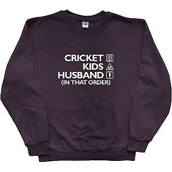Kriketti, lapset, avio mies (siinä järjestyksessä) musta College pusero