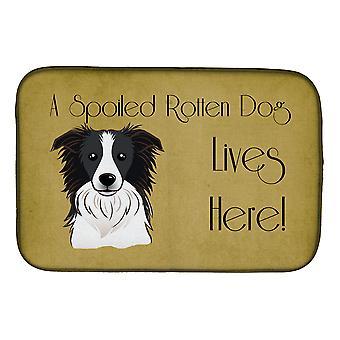 Border Collie pilaantunut koira asuu täällä lautasen kuivaus matto