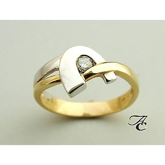 White and yellow gold ring with solitary brilliant