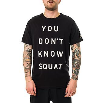 La camiseta para hombre reebok no conoce el bq8288 en cuclillas