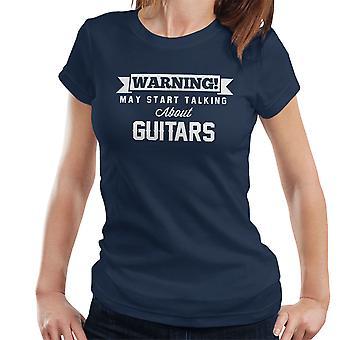 警告は、ギターの女性の T シャツについて話し始めるかもしれない