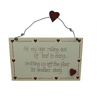 At My Age Rolling Out Of Bed Is Easy Novelty Wall Plaque
