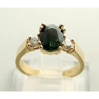 Christian gold ring with green sapphire