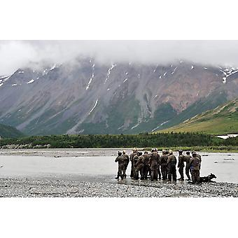 A group of Navy SEALs prepares to cross Phelan Creek Poster Print by Stocktrek Images