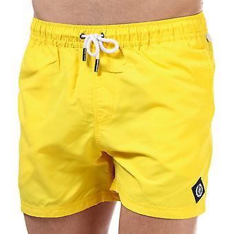 """Hombres"""", ropa de playa Henri Lloyd en amarillo"""