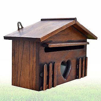 Luova puinen ulkopostilaatikko