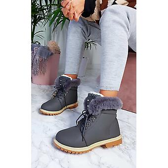 أحذية الرباط فو الفراء النسائية كلارا إيكروش فوق صحراء