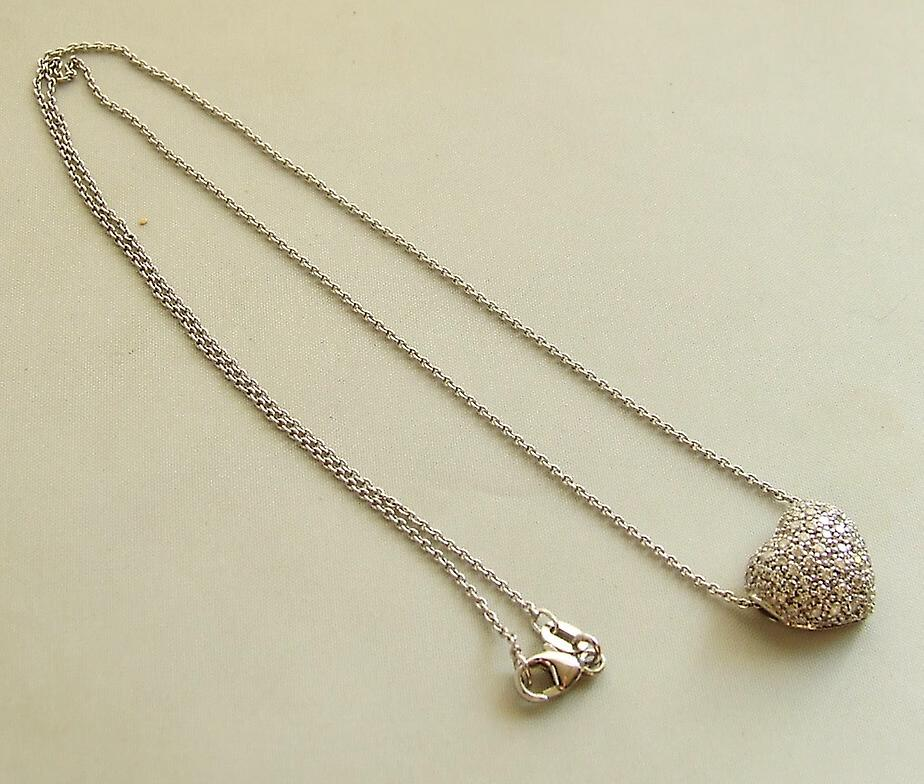 White gold necklace and hearts pendant with diamonds