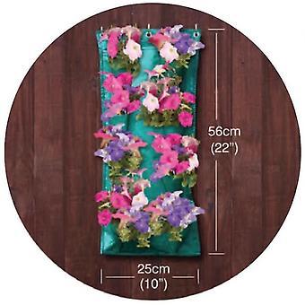 Hierbas colgantes y flores crecen bolsa de guirnalda flor manga creciendo fuera jardín de la puerta