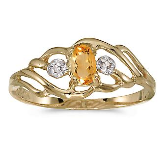 LXR 10k Yellow Gold Oval Citrine and Diamond Ring 0.15 ct