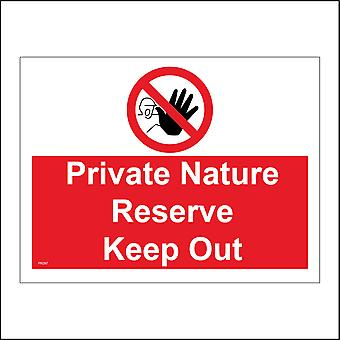 PR287 Private Nature Reserve Keep Out Sign with Red Circle Diagonal Line Hand