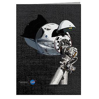 NASA SpaceX Dragon -kapseli ISS-onnittelukortilla