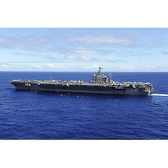 El portaaviones USS Abraham Lincoln transita a través de la impresión del cartel de Pacífico