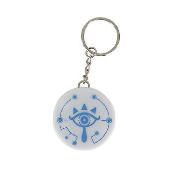 La leggenda di Zelda LED Keychain Sheikah eye bianco/blu, stampati, plastica, con la funzione LED.