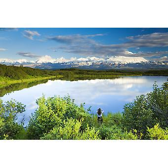 Female Tourist Viewing Mt Mckinley From The Edge Of Refleciion Pond In The Late Evening Denali National Park Interior Alaska PosterPrint