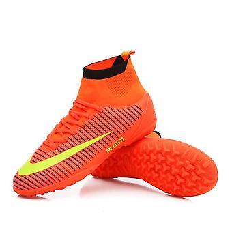 Scarpe sportive da calcio con tacchette alla caviglia alta