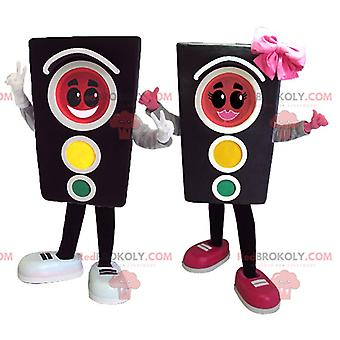 2 MASCOT REDBROKOLY.COMs of traffic lights a girl and a boy