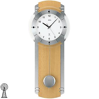 Radio controlled wall clock with pendulum wooden rear wall silver chrome applications