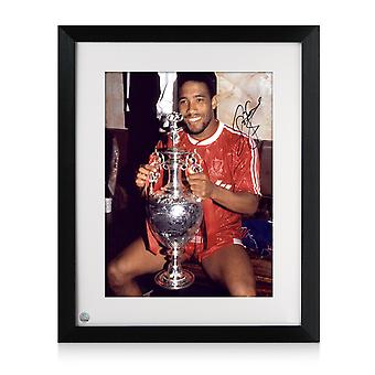 John Barnes Signed Liverpool Photo: Holding The League Championship. Framed