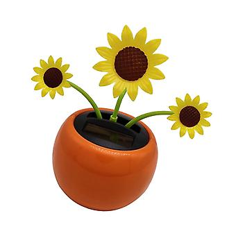 Solar Powered Dancing Sun Flower - Auringonkukkakorista toimistoauton kojelaudalle.