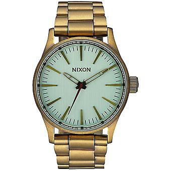 Nixon Sentry Quartz Analog Woman Watch with A4502230 Gold Plated Stainless Steel Bracelet