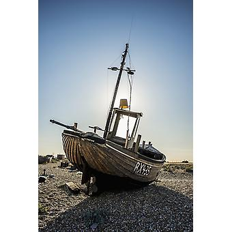 Old boat on a shingle beach Dungeness Kent England PosterPrint
