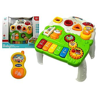Children's toy music table with piano and sounds