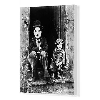 CHAPLIN: THE KID, 1921. Charlie Chaplin and Jackie Coogan as his adopted son in. Box Canvas Print..