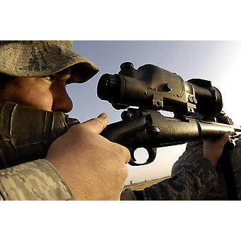 November 14 2007 - An airman slowly squeezes the trigger of his M-24 sniper rifle the military version of a Remington 700 near Kirkuk Regional Air Base Iraq Poster Print