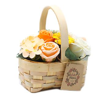 Bouquet orange moyen en panier en osier X 1