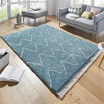 Concevoir des tapis épais Ruby Blau avec franges