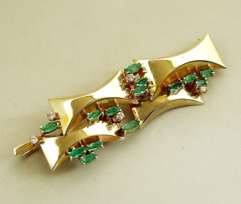 Gouden broche met diamanten en smaragd