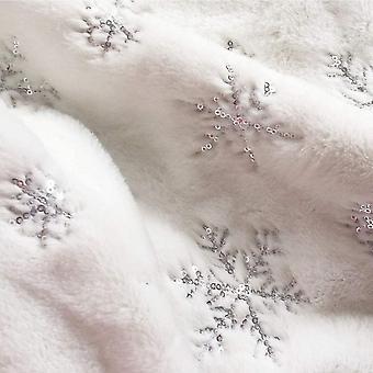 Pluszowy koc stojący na choince nadaje się do dekoracji choinki