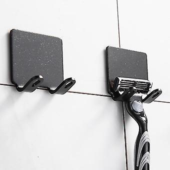 2 kappaletta seinään kiinnitettävää partakoneenpidikettä (musta)