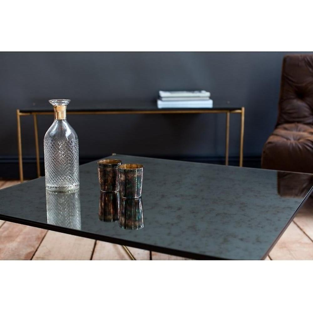 Gillmore Antiqued Glass Rectangular Coffee Table With Brass Cross Base