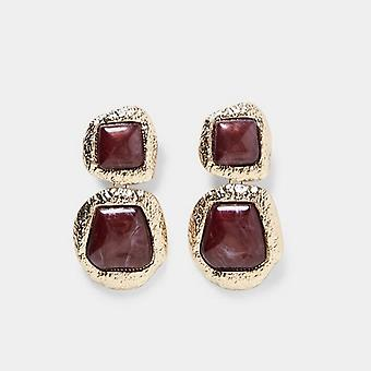 Earring in gold with red large stones