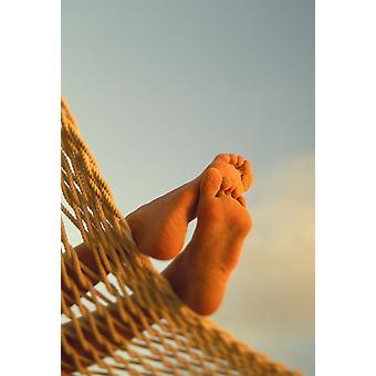 Close-Up Of Bottom Womans Feet Crossed Hammock With Golden Afternoon Light Sand PosterPrint