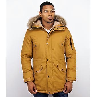Long Men's winter coat – with fur collar – yellow
