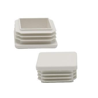 Valkoinen muovinen neliötuoli pöydän jalat korkki