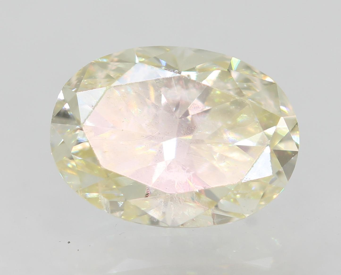 Certified 0.71 Carat I SI1 Oval Enhanced Natural Loose Diamond 6.63x4.86mm 2VG