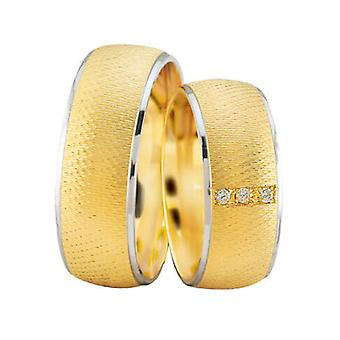 Gold wedding rings with white gold edge