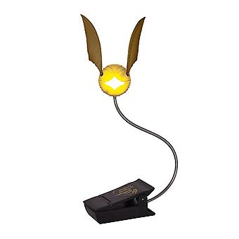 Harry Potter Golden Schnatz Lumi Clip black/transparent, printed, made of plastic, in gift wrapping.