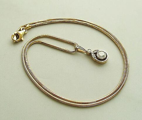 Gouden druppel hanger met ketting