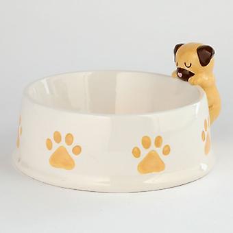 Puckator ruskea koira reunalla lemmikkieläinten ruokakulho