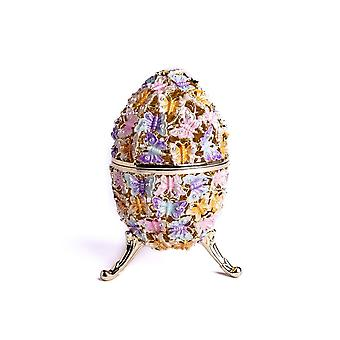 Kultainen faberge-muna koristeltu perhos-helylaatikolla