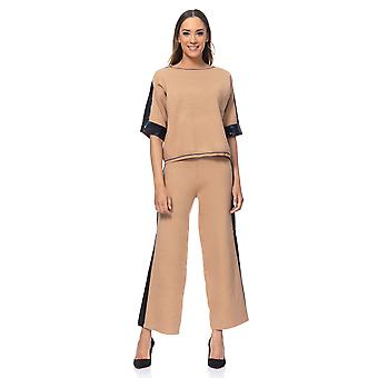 Knited set of pants and top  with side Lurex Ribbon. Pants with wide shape and elastic waist and top with round neck and 3/4 sleeves
