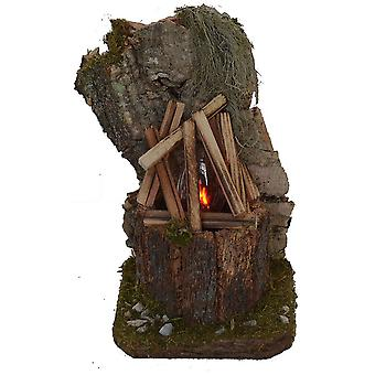 Crib accessories nativity scene crib set campfire flicker light in front of cork rocks