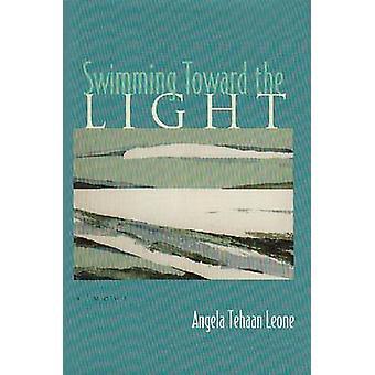 Pływanie w kierunku światła - powieść przez Angela Tehaan Leone - 978081560