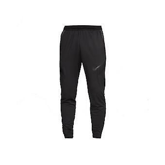 Nike JR Dry Strike BV9460010 treinando calças de menino durante todo o ano