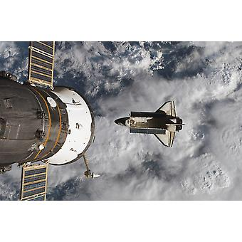 Space Shuttle Atlantis and the docked Soyuz spacecraft Poster Print